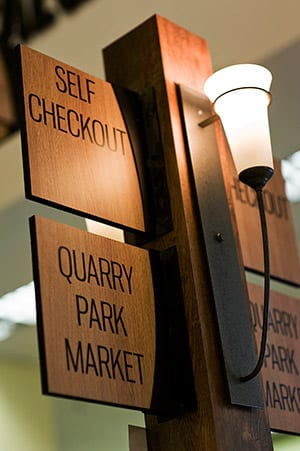 Store signage for self checkout at Quarry Park Market