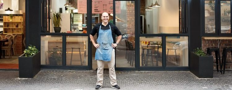 Entrepreneur standing in front of his fast food restaurant